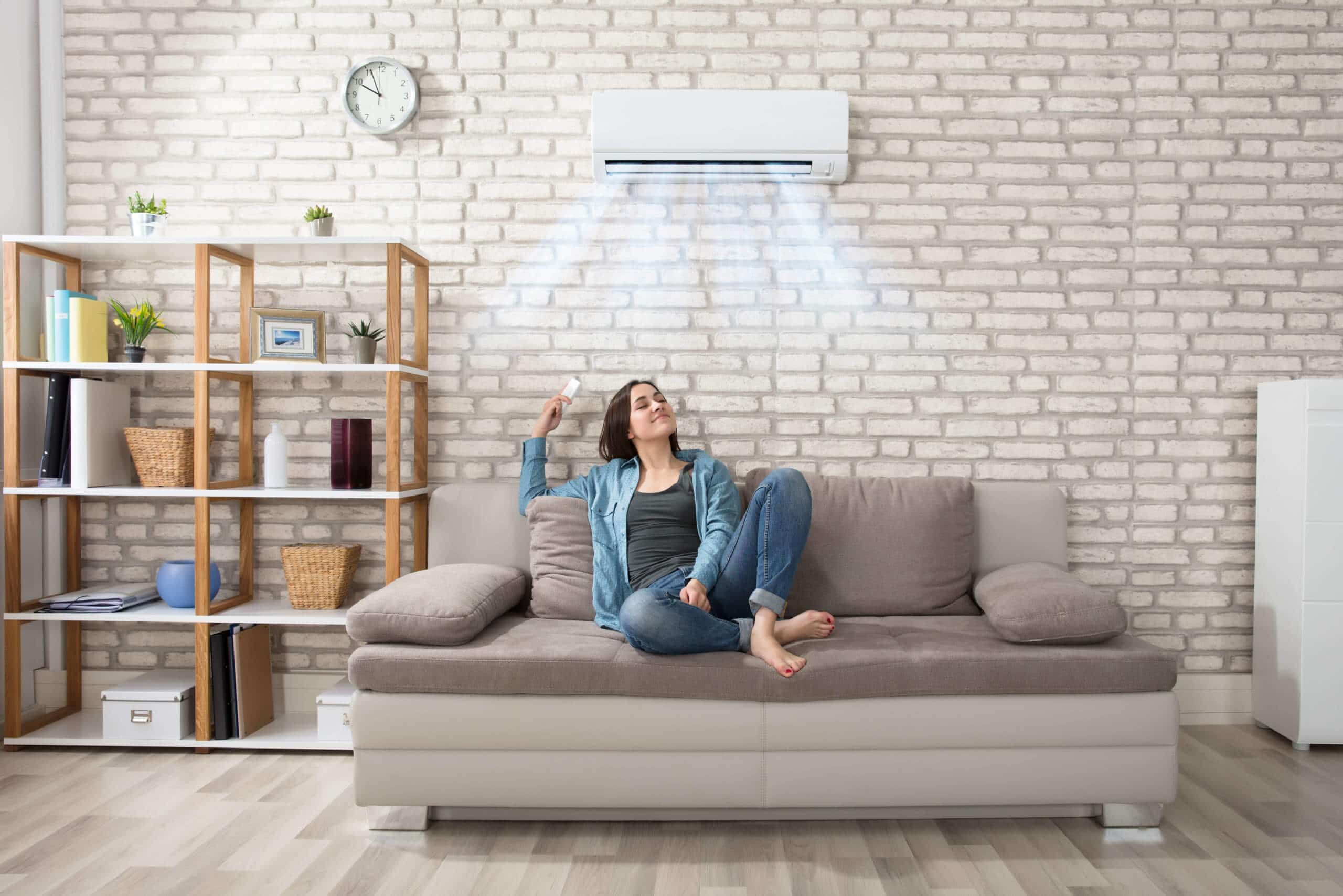 Woman enjoys cool air conditioning in her home