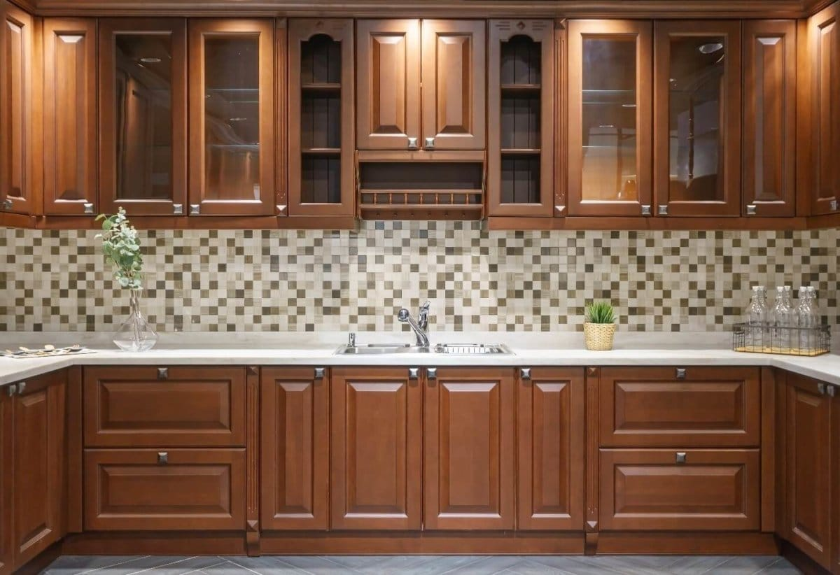 Brown wooden cabinets inside of a homes kitchen with marble countertops