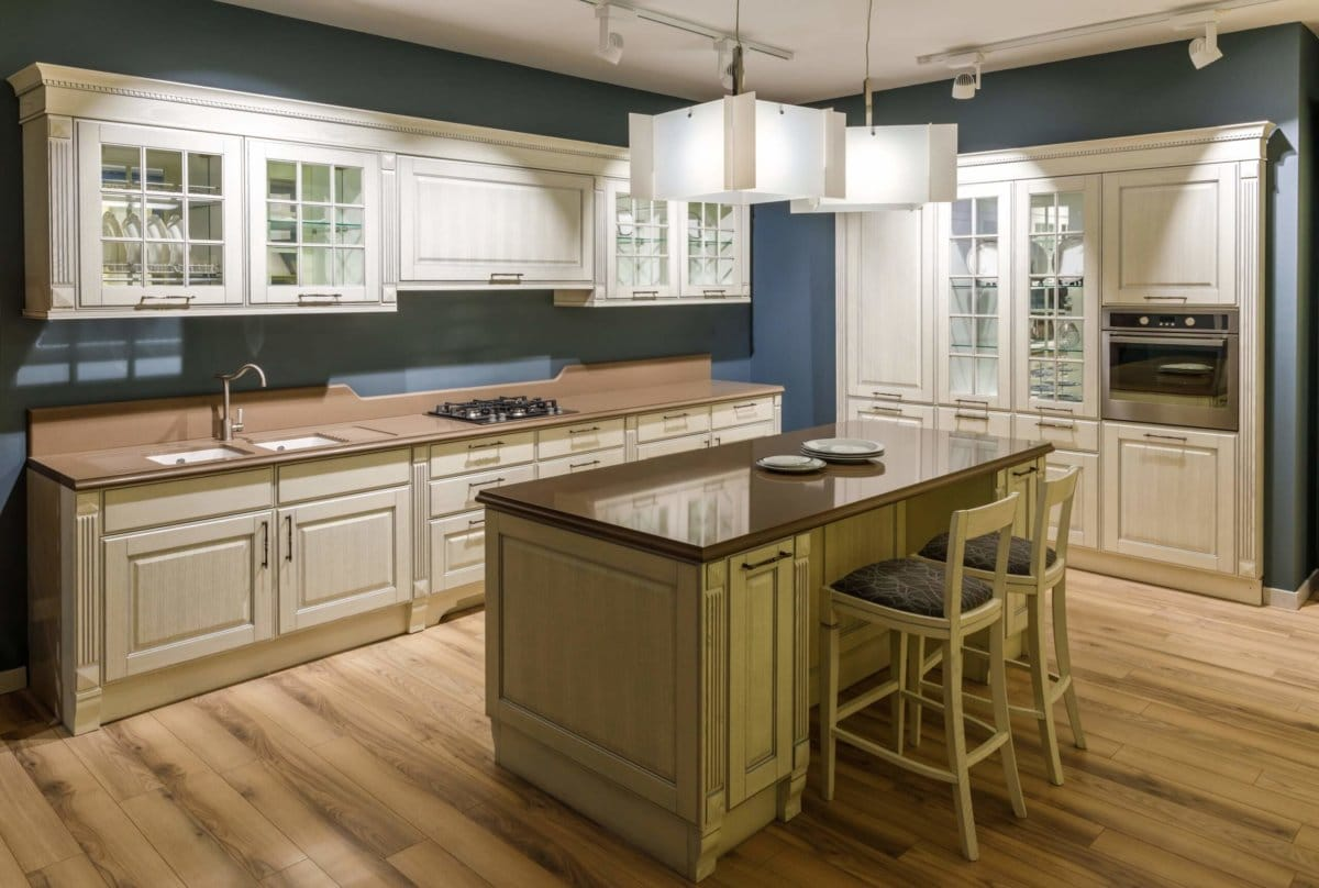 Interior of modern kitchen with wooden cabinets